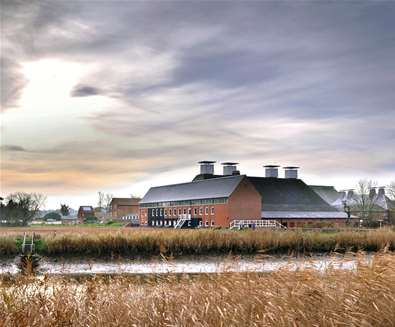 Aldeburgh-Music-and-Snape-Maltings-Concert-Hall-from-across-the-River-Alde-(c)-Philip-Vile---1