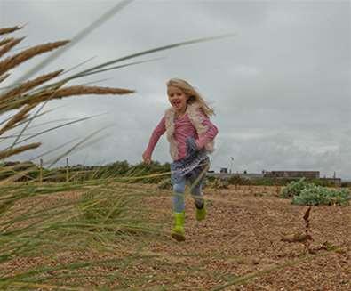 Articles - Plan your Half Term - Girl on Felixstowe Beach (c) Emily Fae Photography