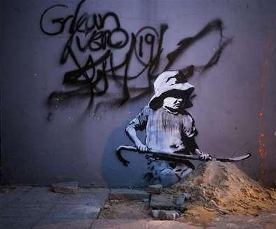 Banksys - Child digging - (c) Adam Barnes