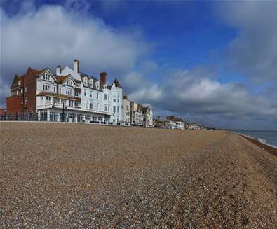 Where to stay - Brudenell Hotel - Aldeburgh - Exterior  image of Brudenell Hotel looking up from the  shingle beach credit TA Hotel Collection
