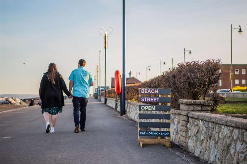 Towns & Villages - Felixstowe - couple walking along the prom