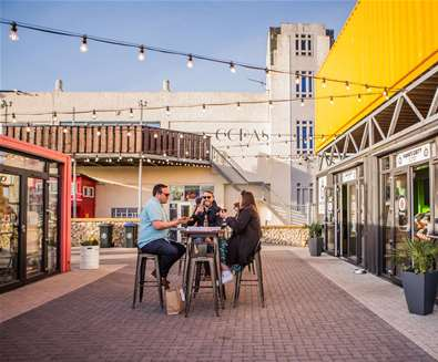 TTDA - Beach Street Felixstowe - Friends at table (c) Emily Fae Photography