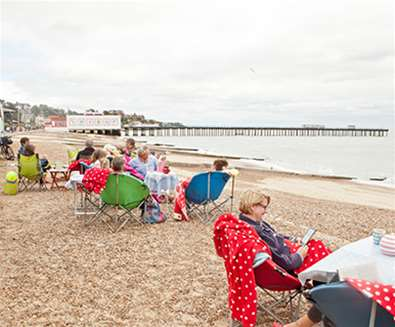 Felixstowe Beach - People sat on beach - Emily Fae Photography