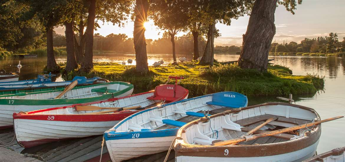 Boats for hire on Thorpeness Meare on the Suffolk Coast