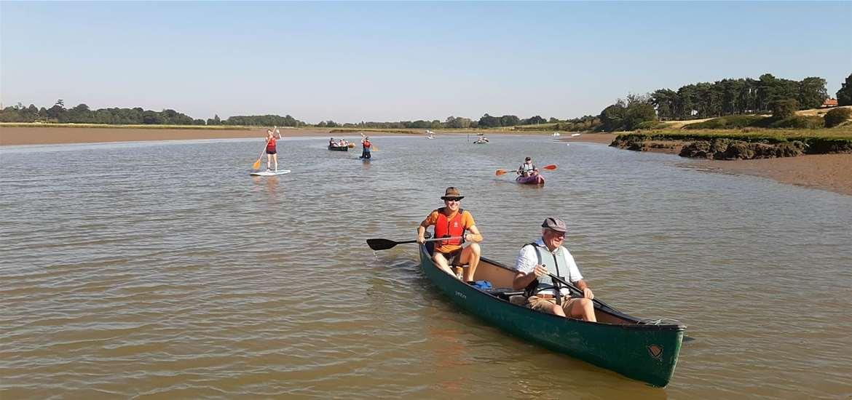 TTDA - Iken Canoe - canoes returning