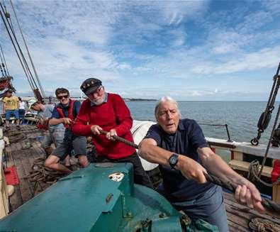 TTDA - Excelsior - Men on boat