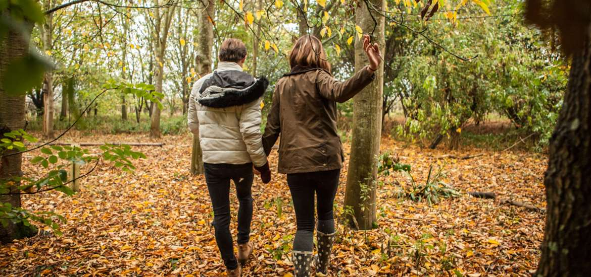 Couple in Woods  - Photograph by Emily Fae