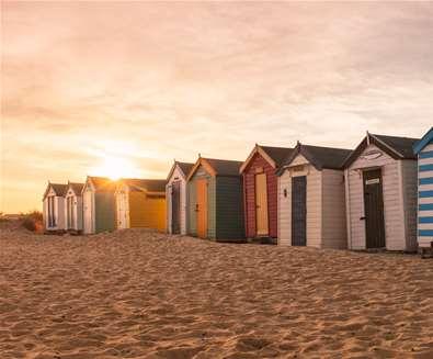 Southwold Beach Huts at Sunset