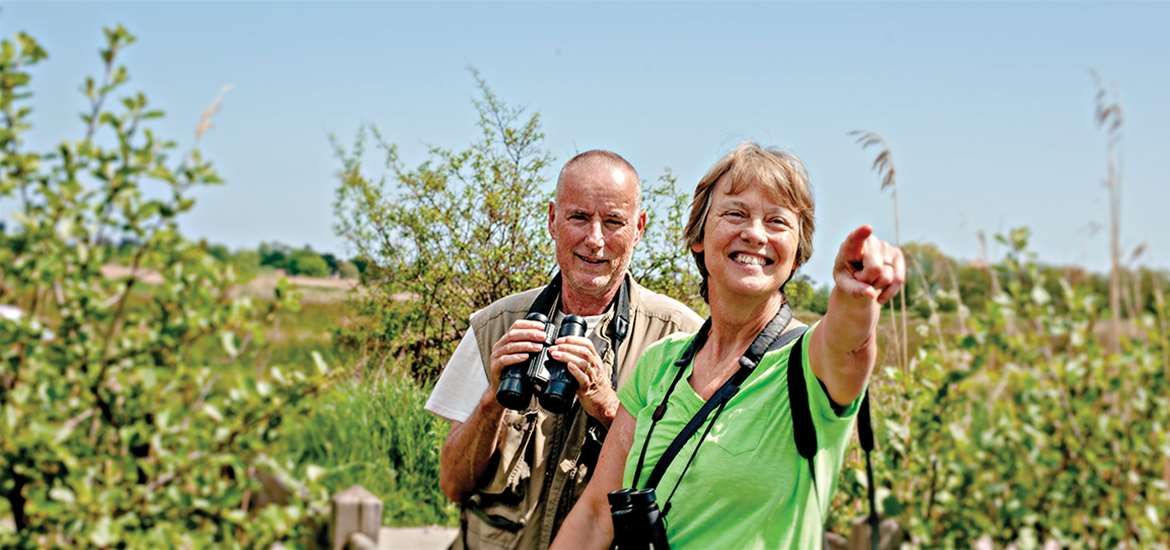 TTDA - Suffolk Wildlife Trust - Couple with Binoculars (c) John Ferguson