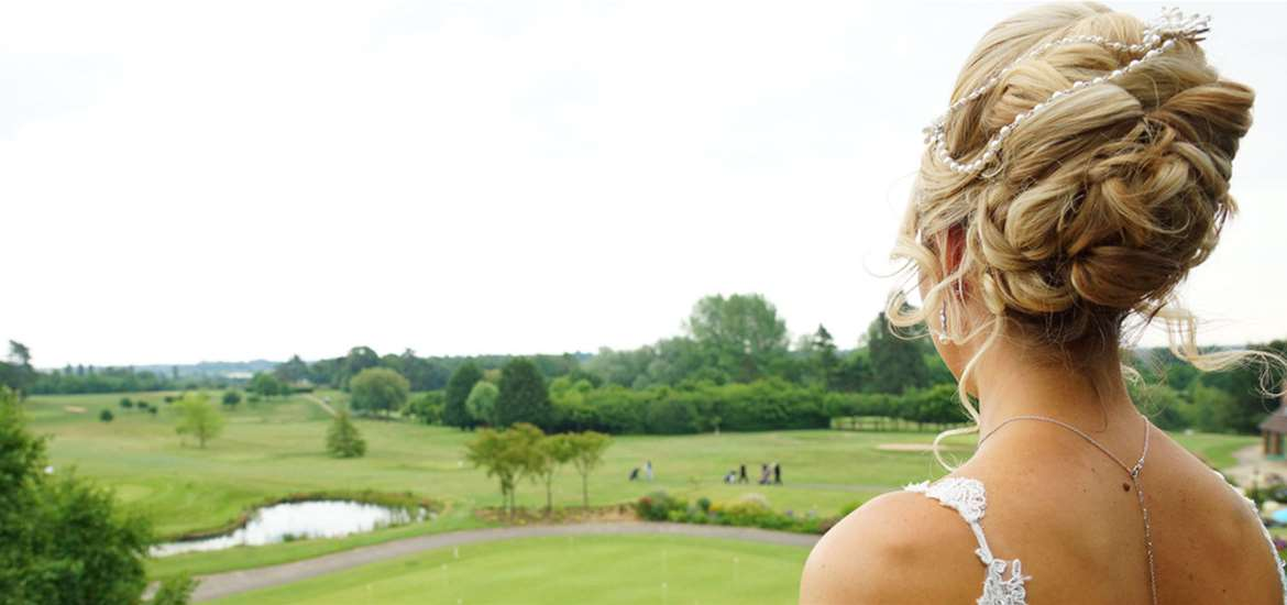 Weddings - Ufford Park - Bride looking over course